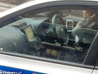 cop-on-phone-no-hands