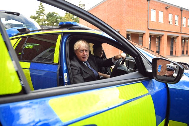 Prime Minister Boris Johnson sitting in the driver's seat of a police vehicle during a visit to Northamptonshire Police Headquarters in Northampton (Stefan Rousseau/PA)